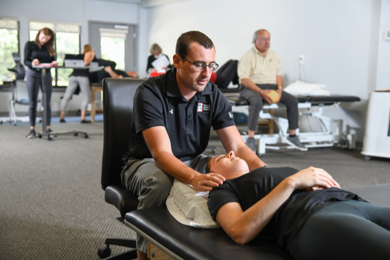therapist performing therapy on patient's neck