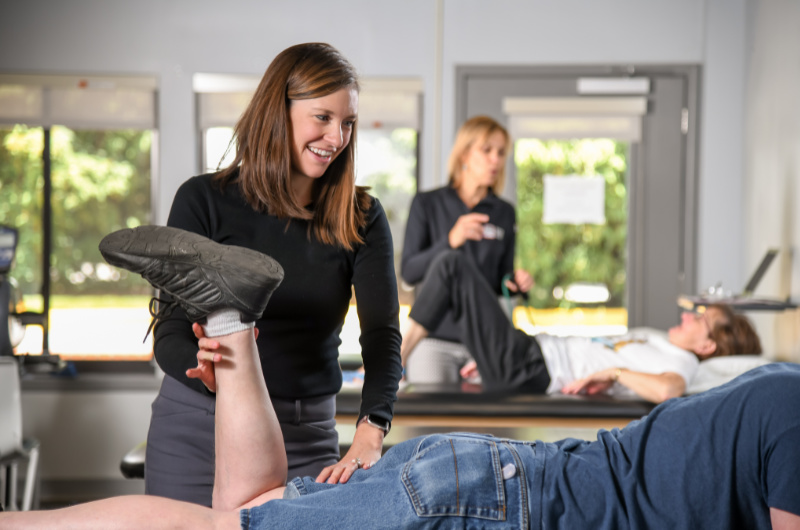 therapist performing therapy on patient's lower leg